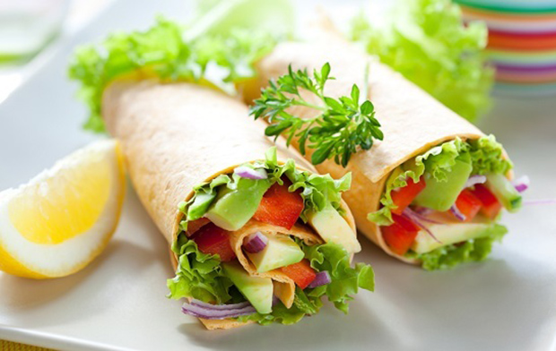 fresh  tortilla wraps with vegetables on the plate